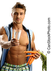 Healthy lifestyle - Young athletic man having glass of water