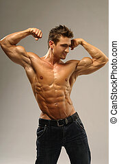 Muscleman - Athletic man showing muscles