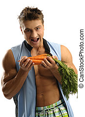 Healthy lifestyle - Young athletic man eating carrots