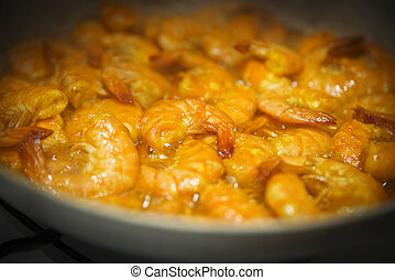 various fried and spicy prawns with turmeric powder