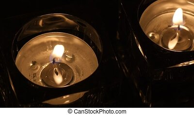 Close up two tealights in holder evening - Close up shot of...