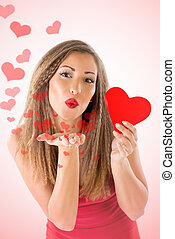Blowing A Kiss - Beautiful smiling girl holding red heart....