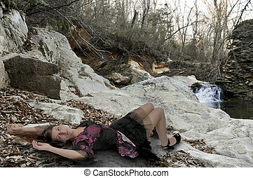 Woman Laying Down - Young woman in a short dress laying down