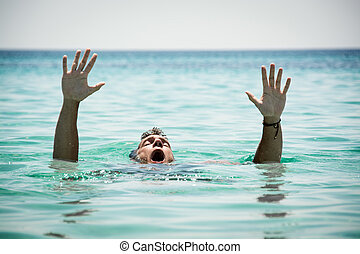 Drowning Man - Drowning man in sea asking for help with...