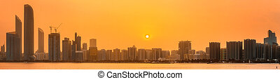 Abu Dhabi Skyline - View of Abu Dhabi Skyline at sunset,...