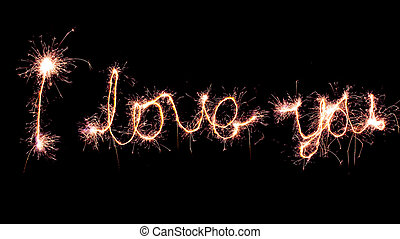 """""""I love you"""" sign made by sparkler."""