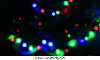 multicolored lights in the New Year holidays in the night -...