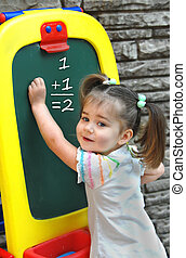At Preschool Learning Math - Little girl begins to learn by...