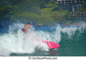 Braving the Waves - Gaining momentum, surfer and his bright...