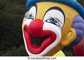 Creepy clown balloon - Creepy clown face balloon smiling on...