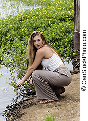 Caucasian Teen Girl Squatting On River Bank - Caucasian Teen...