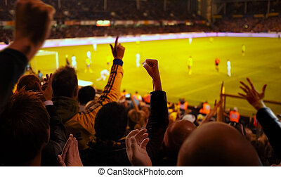 Football Excitement - Fans excited at a football game,...