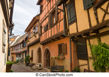 Timbered houses in the village of Eguisheim in Alsace,...