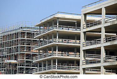 immense building under construction with concrete walls in...