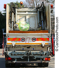 urban sanitation trucks during the collection of solid waste in