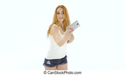 Girl model looks poses for selfie photos on phone. Studio -...