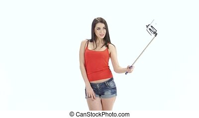 Girl of model appearance makes selfie photos using a...