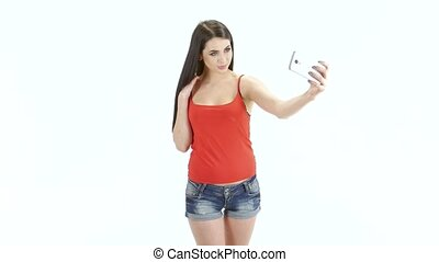 Selfie photo on the mobile phone makes brunette girl model -...