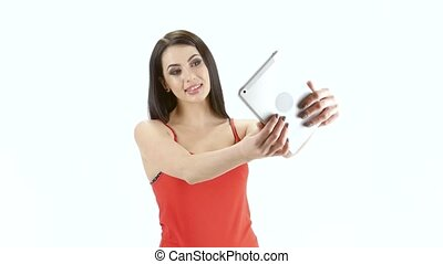 Selfie photo using the front camera of the tablet. Studio -...