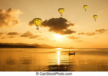 Beauty hot air balloon over sea sunset background