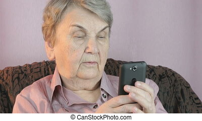 Old woman taking selfie using cellphone - Old woman taking...