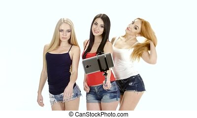 Three girl model pose for a selfie photo. White background -...