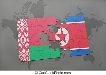 puzzle with the national flag of belarus and north korea on...