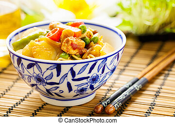 Chow mein - stir-fried noodles with vegetables and tofu