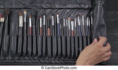 Closeup of professional cosmetics makeup brushes kit