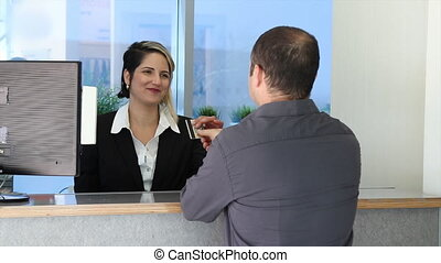 Customer pay with credit card - Customer giving credit card...