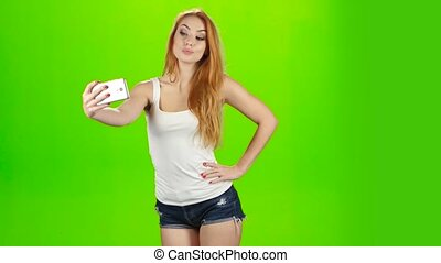 Selfie photos on mobile phone, poses redhead girl model....