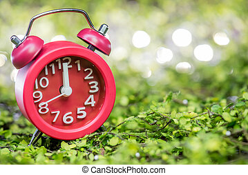 Red clock at midnight time
