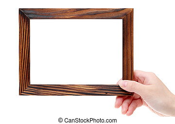 Hand holding blank wooden frame on white background