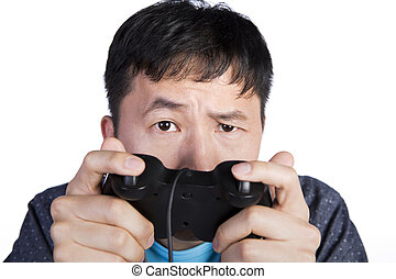 asian man staring to his front because he plays too hard,...