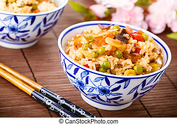 fried rice with vegetables, eggs and mushrooms - tasty fried...