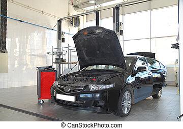 black car - The image of black car under repair