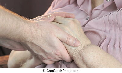 Man soothes the elderly woman during the stress - Man...