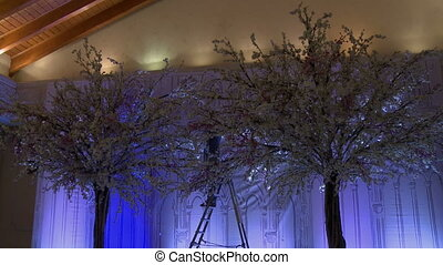 Artificial trees with garlands for wedding party - Designer...