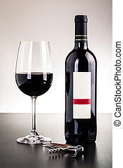 Red wine bottle and glass - a blank labeled bottle of wine...