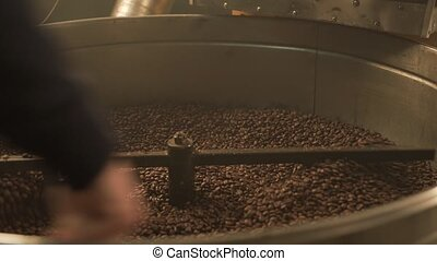 Coffee bean mixing device at work - Machine for roasting...
