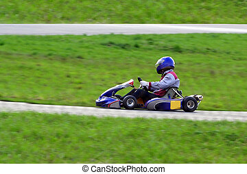 karting - The racer in the car for go-cart racing on a line