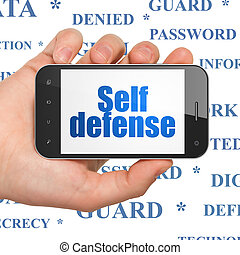 Privacy concept: Hand Holding Smartphone with Self Defense...