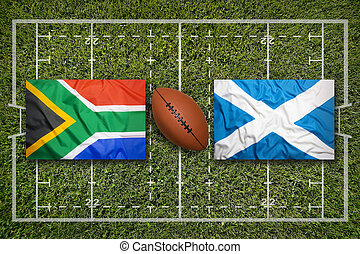South Africa vs. Scotland flags on rugby field