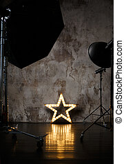 Photography studio with lighting equipment and decoration...