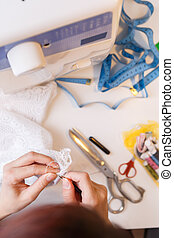Young girl engaged in needlework - Girl is engaged in...
