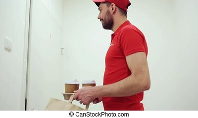 man delivering coffee and food to customer home - delivery,...