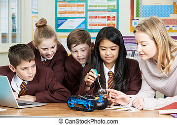 Pupils And Teacher In Science Lesson Studying Robotics