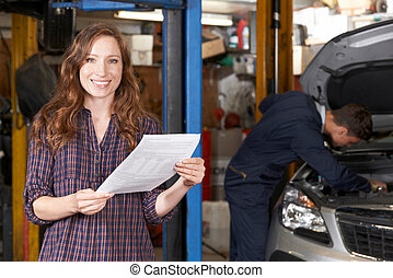 Female Customer In Auto Repair Shop Satisfied With Bill For...