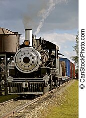 Old steam locomotive freight train - An old steam locomotive...