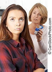 Mother Talking To Teenage Daughter About Dangers Of Smoking